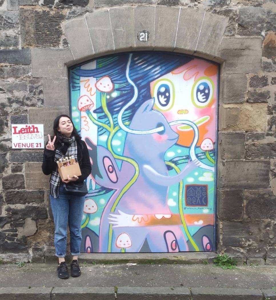 Just a girl, six bottles of kombucha, and some street art by Ursula Kam-Ling Cheng https://ursula-cheng.com/